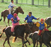 young jockeys on horses